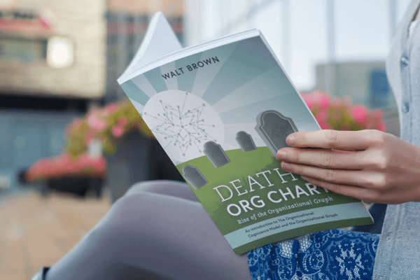 Woman Reading Death Of the Org Chart